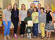Books Between Kids gives away their one-millionth book to Piney Point ES second-grader Justin Ikwuagwu, who is from Nigeria.