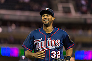 Aaron Hicks #32 of the Minnesota Twins smiles after he robbed a home run against the Chicago White Sox on May 13, 2013 at Target Field in Minneapolis, Minnesota.  The Twins defeated the White Sox 10 to 3.  Photo: Ben Krause