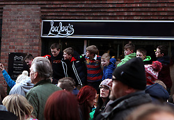 Young spectators try to view the action from an elevated position - Mandatory byline: Robbie Stephenson/JMP - 09/02/2016 - FOOTBALL -  - Ashbourne, England - Up'Ards v Down'Ards - Royal Shrovetide Football
