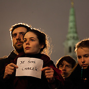 "Many held up signs declaring "" je suis Charlie"". Londoners show their solidarity with the 12 people killed in an attack on the magazine Charlie Hebdo in Paris and their revulsion of the attack on freedom of speech at a vigil in Trafalgar Square. Three attackers killed ten journalist working for Charlie Hebdo and two police officers, the worst terrorist attack in Paris, France in 50 years."