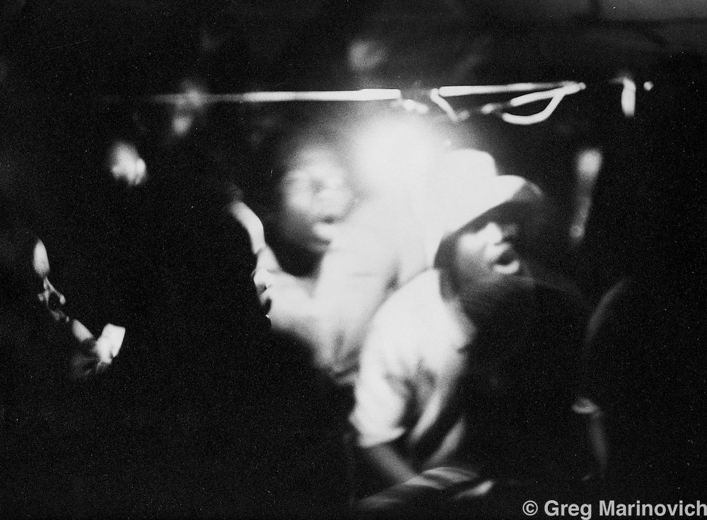Venda, 1989: <br /> African National Congress supporters do the toyi-toyi dance at the night vigil of a comrade killed by security forces in the Venda homeland, in the far north of South Africa. The ANC was still a banned organisation then, and represented by other organisations.<br /> Photograph by Greg Marinovich