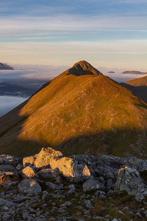 Morning light bathes the Buchaille Etive Beag range in Glencoe, Scotland