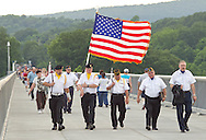 Highland, New York - A color guard walks with the American Flag on the Walkway over the Hudson on May 27, 2012. A Memorial Day ceremony was held at the center of the walkway at dusk.