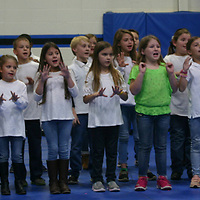 Hamilton students show their support of veterans with a song.