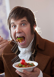 Robert Burns lookalike Chris Tait samples controversial.restaurant Kismot's new Burn's Day haggis curry, with Abdul Ali from Kismot. Trying the Killer curry..Pic © Michael Schofield...