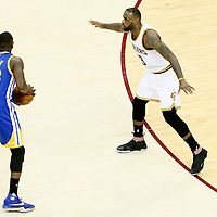 10 June 2016: Cleveland Cavaliers forward LeBron James (23) defends on Golden State Warriors forward Draymond Green (23) during the Golden State Warriors 108-97 victory over the Cleveland Cavaliers, during Game Four of the 2016 NBA Finals at the Quicken Loans Arena, Cleveland, Ohio, USA.
