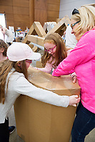 Repro Free: The People Build. In preparation for the spectacular architectural event devised by french artist Olivier Grossetete , The people of Galway are preparing 4,000  cardboard  boxes for a new structure built by the people (Saturday) and demolished by the   people on Sunday.<br />   Emer, Aoife and mum Cliona O'Shea  from Dublin helping out with the build.<br />  .  Photo:Andrew Downes, xposure