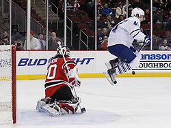 Jan 29, 2010; Newark, NJ, USA; New Jersey Devils goalie Martin Brodeur (30) makes a save through a screen by Toronto Maple Leafs left wing Nikolai Kulemin (41) during the first period at the Prudential Center.