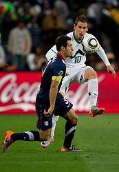 Carlos Bocanegra of USA vs Valter Birsa of Slovenia during the 2010 FIFA World Cup South Africa Group C match between Slovenia and USA at Ellis Park Stadium on June 18, 2010 in Johannesberg, South Africa. (Photo by Vid Ponikvar / Sportida)