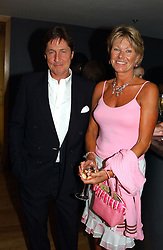 SIMON & KATE SLATER she was formerly Kate Menzies, a close friend of the late Diana, Princess of Wales at a party to celebrate the UK launch of Diana:The Portrait, the authorised book about the late Princess Of Wales's life and work, held at the National Portrait Gallery, London on 1st September 2004.  The book was commissioned by The Diana, Princess of Wales Memorial Fund and writen by Ros Coward.
