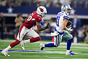 ARLINGTON, TX - AUGUST 26:  Cole Beasley #11 of the Dallas Cowboy is tackled from behind by Budda Baker #36 of the Arizona Cardinals at AT&T Stadium during week 3 of the preseason on August 26, 2018 in Arlington, Texas.  The Cardinals defeated the Cowboys 27-3.  (Photo by Wesley Hitt/Getty Images) *** Local Caption *** Cole Beasley; Budda Baker