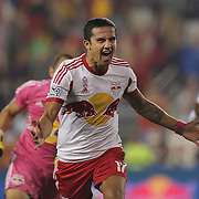 Tim Cahill, New York Red Bulls, heads to the corner flag to celebrate with his trademark corner flag punch after his 97th minute  header leveled the scores at 2-2 during the New York Red Bulls V New England Revolution, Major League Soccer regular season match at Red Bull Arena, Harrison, New Jersey. USA. 5th October 2013. Photo Tim Clayton