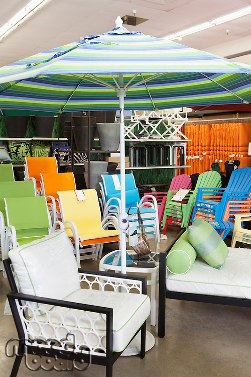 Seating furniture and patio umbrella for sale in garden furniture store