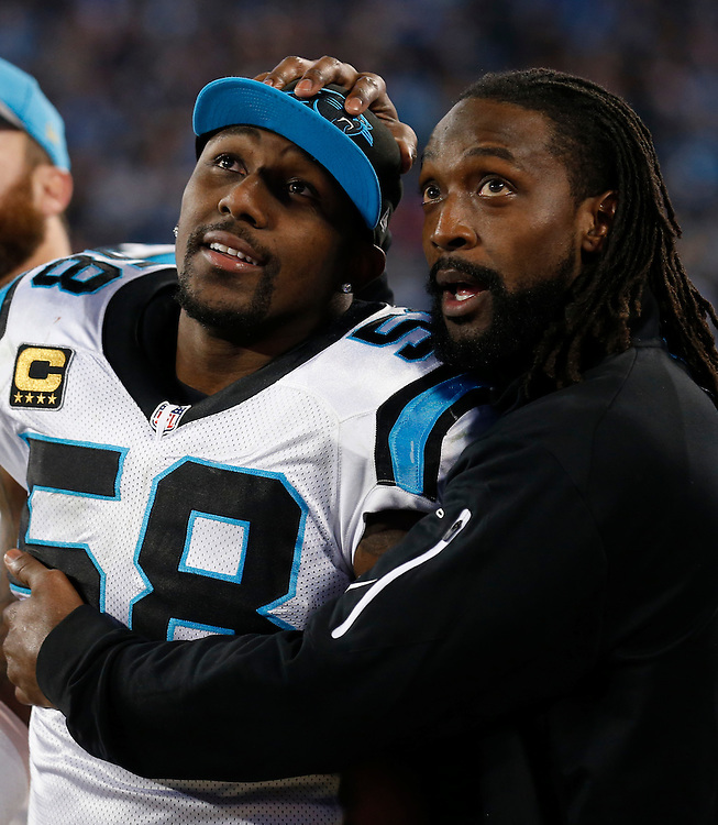 CHARLOTTE, NC - JAN 24:  Linebacker Thomas Davis #58 and cornerback Charles Tillman #31 of the Carolina Panthers embrace and celebrate during the NFC Championship game against the Arizona Cardinals at Bank of America Stadium on January 24, 2016 in Charlotte, North Carolina.