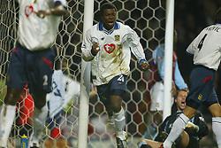 BIRMINGHAM, ENGLAND - Tuesday, January 6, 2004: Portsmouth's Aiyegbeni Yakubu celebrates scoring an equaliser against Aston Villa during the Premiership match at Villa Park. (Pic by David Rawcliffe/Propaganda)