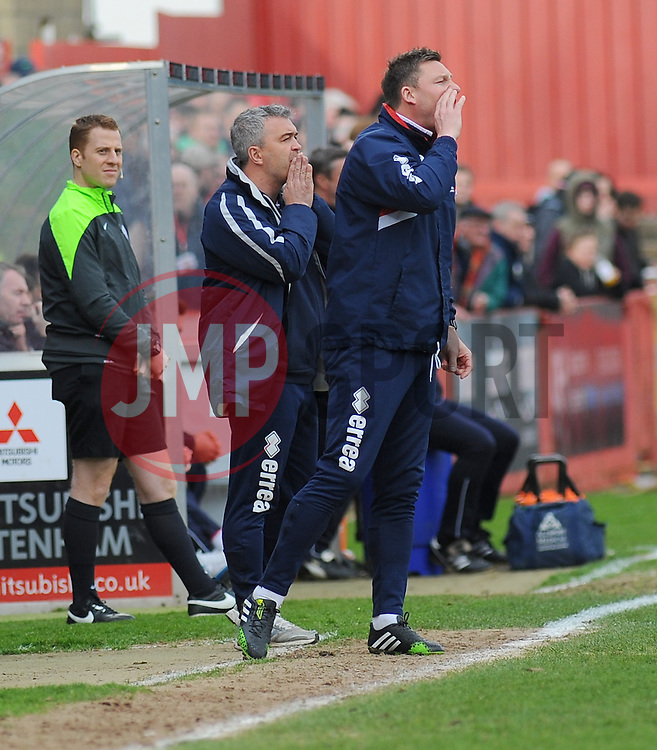Cheltenham Town Manager, Russell Milton and Cheltenham Town's Assistant Manager Steve Elliott give orders from the side line.  - Photo mandatory by-line: Nizaam Jones - Mobile: 07966 386802 - 28/03/2015 - SPORT - Football - Cheltenham - Whaddon Road - Cheltenham Town v Plymouth Argyle - Sky Bet League Two