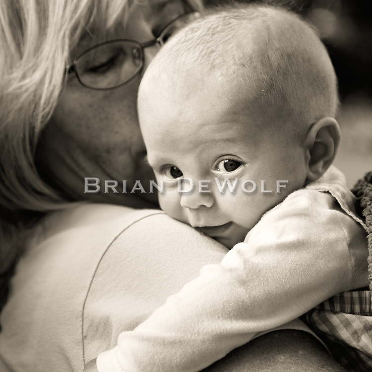 Little William secure in Grandma's arms.  Aspect Ratio 1w x 1h.