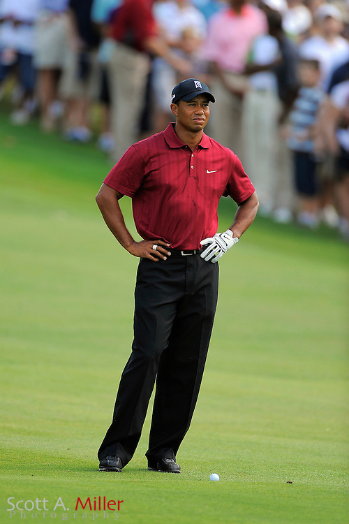 Tiger Woods (USA) prepares for his third shot on the first hole during the final round of the PGA Tour Championship the final event of the 2009 FedEx Cup at East Lake Golf Club on Sept. 27, 2009 in Decatur, Ga.     ..©2009 Scott A. Miller