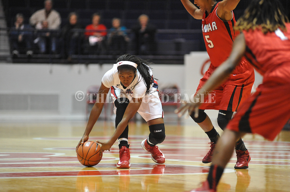"""Ole Miss' Danielle McCray (22) vs. Lamar's Kalis Loyd (5) in women's college basketball at the C.M. """"Tad"""" Smith Coliseum in Oxford, Miss. on Monday, November 19, 2012.  Lamar won 85-71."""