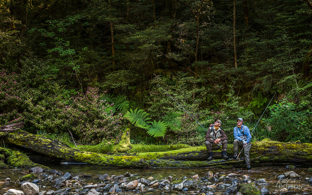 Two anglers take a break to admire one of fly fishing's most epic surroundings--South Island, NZ