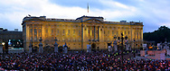 Crowds gathering at dusk outside Buckingham Palace to watch a video link to a special rock concert being held in the palace grounds to celebrate Queen Elizabeth II's Golden Jubilee.Celebrations took place across the United Kingdom with the centrepiece a parade and fireworks at Buckingham Palace, the Queen's London residency. Queen Elizabeth ascended to the British throne in 1952 upon the death of her father, King George VI.