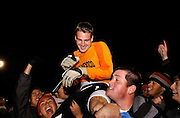 Steven St. John/Tribune..Goalkeeper Mike Graczyk is carried off the field ater defeating Milwaukee-Wisconsin in a overtime shootout win Tuesday at the UNM soccer complex.