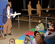 "Storyteller Marti Ventolo (left) holds a model of an airplane at Family Day at the National Museum of the U.S. Air Force, Saturday, January 20, 2007.  She also read from the book ""Young Orville and Wilbur Wright."""