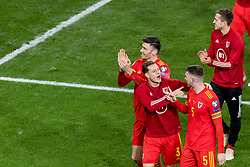 CARDIFF, WALES - Tuesday, November 19, 2019: Wales' Kieffer Moore, James Lawrence and Chris Mepham celebrate after a 2-0 victory ensures qualification to Euro 2020 after the final UEFA Euro 2020 Qualifying Group E match between Wales and Hungary at the Cardiff City Stadium. (Pic by Paul Greenwood/Propaganda)