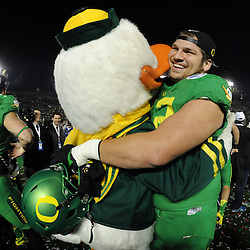 Oregon Ducks's Andre Yruretagoyena hugs the mascot after defeating the Florida State Seminoles 59-20 during the 101st Rose Bowl game in Pasadena, California on Thursday, January 1, 2015.