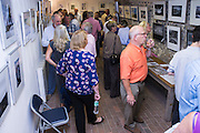 Members and guests of Seaford Photographic Society view the exhibition.<br /> <br /> Opening of the Seaford Photographic Society Exhibition 2016 by former Photo-journalist for Picture Post Grace Robertson. The exhibition will be open 1000-1700 everyday from 13-25 August 2016. Admission free