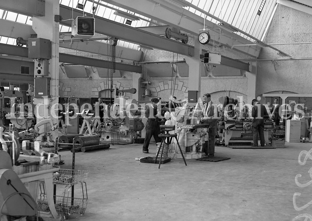 Men working in an unidentified factory. (Part of the Independent Ireland Newspapers/NLI Collection)