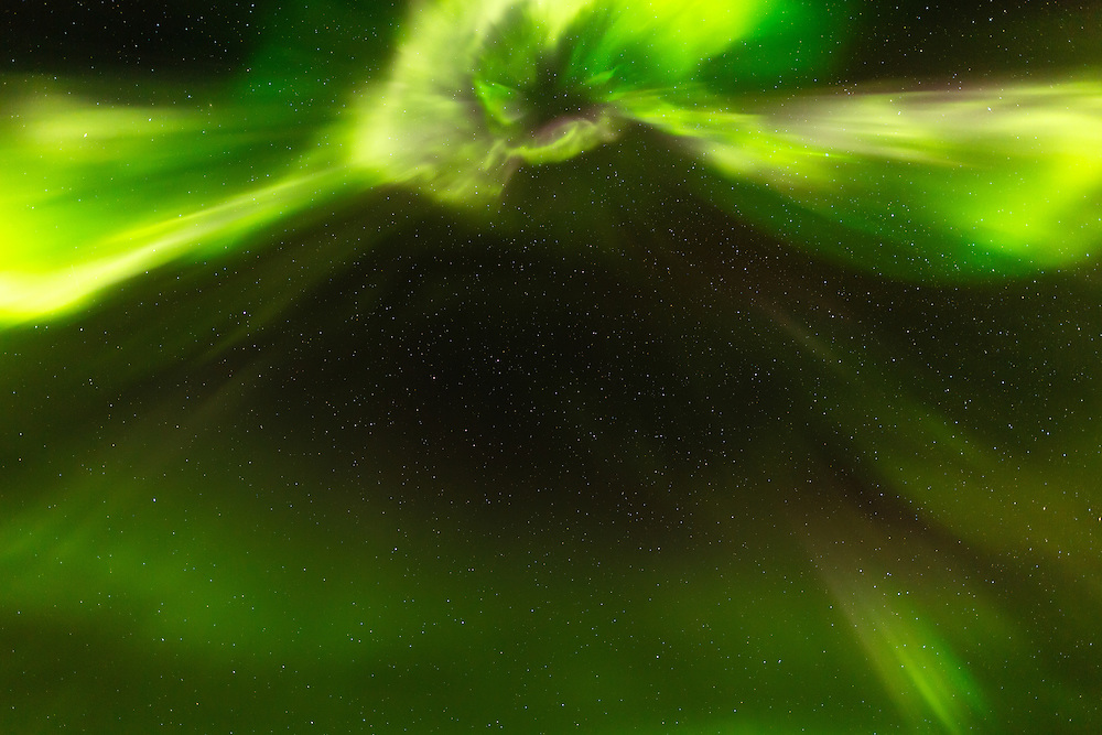 Coronal aurora above Teklanika River in Denali National Park in Interior Alaska. Evening. Autumn.