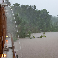 A downpour douses the Delfin II while she is tied to the banks of the Maranon River in the Peruvian Amazon.