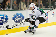 DALLAS, TX - OCTOBER 17:  Marc-Edouard Vlasic #44 of the San Jose Sharks controls the puck against the Dallas Stars on October 17, 2013 at the American Airlines Center in Dallas, Texas.  (Photo by Cooper Neill/Getty Images) *** Local Caption *** Marc-Edouard Vlasic