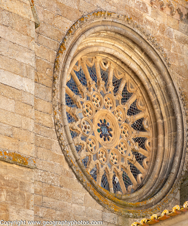 Historic Roman Catholic cathedral church of Évora, Sé de Évora, in the city centre, Basilica Cathedral of Our Lady of Assumption, the largest medieval cathedral in Portugal exterior of building dating from the 16th Century. Round Gothic style window with fine carved stone tracery,