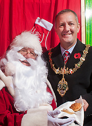 Mayor of Rotherham Cllr Shaun Wright JP is the first to visit Santa at Parkgate Retail World on Friday Morning after he opened the Grotto run by RS Leisure 114495-2.11 November 2011. Image © Paul David Drabble