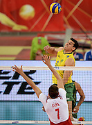 LODZ, POLAND - SEPTEMBER 16: Sidnei Dos Santos Jr of Brazil spikes the ball during the FIVB World Championships match between Poland and Brazil on September 16, 2014 in Lodz, Poland. (Photo by Piotr Hawalej)