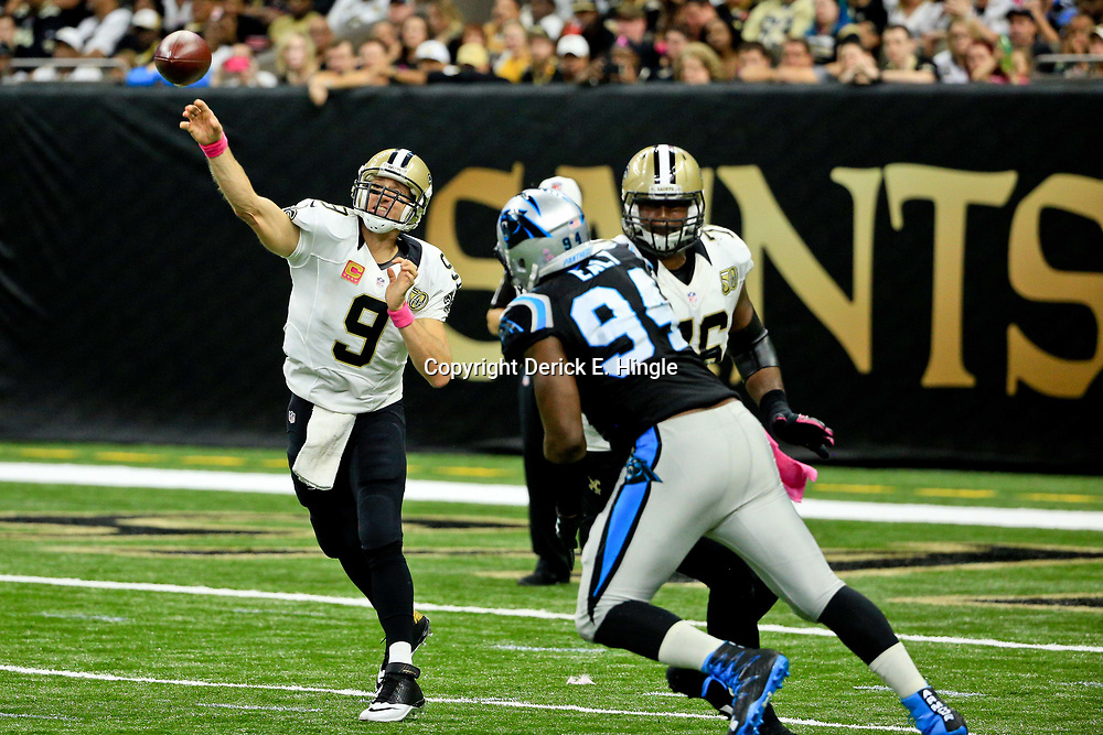 Oct 16, 2016; New Orleans, LA, USA; New Orleans Saints quarterback Drew Brees (9) throws against the Carolina Panthers during the fourth quarter of a game at the Mercedes-Benz Superdome. The Saints defeated the Panthers 41-38. Mandatory Credit: Derick E. Hingle-USA TODAY Sports