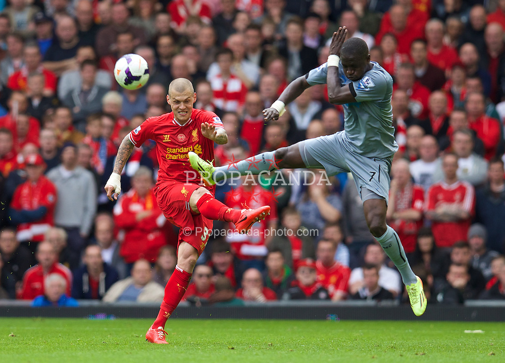 LIVERPOOL, ENGLAND - Sunday, May 11, 2014: Liverpool's Martin Skrtel in action against Newcastle United's Moussa Sissoko during the Premiership match at Anfield. (Pic by David Rawcliffe/Propaganda)