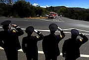 CDF Firefighters, Shaun Jewett, Trish Raye, Dale McInturf and Scott McKinney salute the fire truck carrying the flag draped coffin of California Department of Forestry firefighter Eva Marie Schicke, as they turn on off Highway 4 in Calaveras County, Calif., Monday, Sept. 20, 2004. Schicke died Sept. 12 while battling a fire in Stanislaus National Forest. Several hundred fire trucks from around the state followed in the procession to the Calaveras County Fairground for the memorial services.