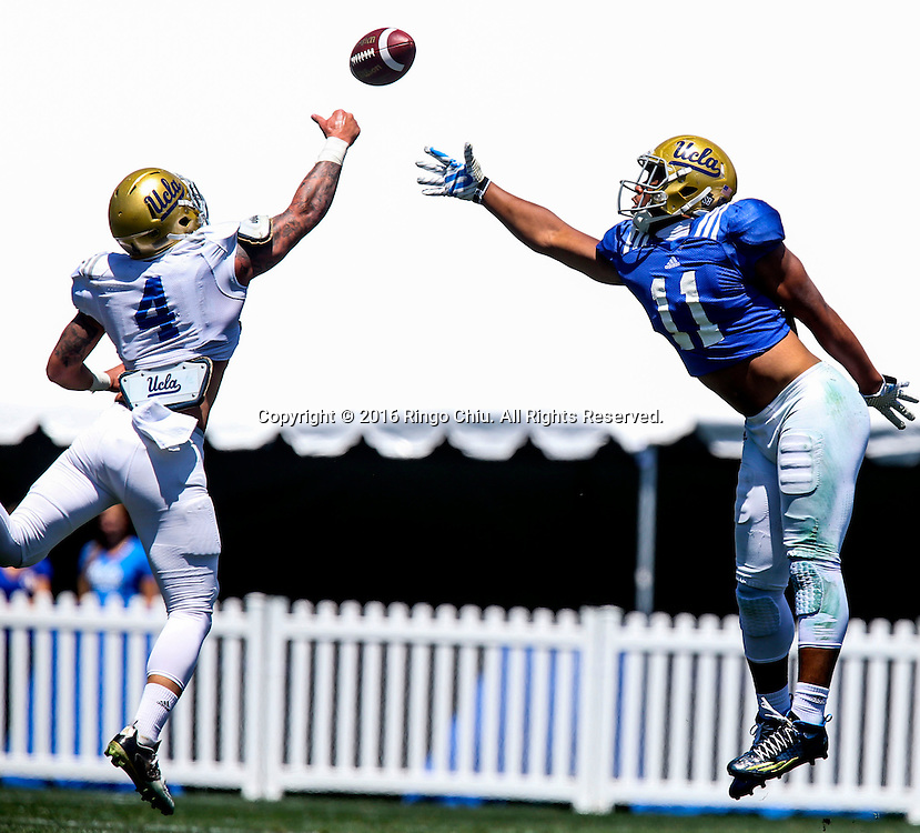 LOS ANGELES, CA - APRIL 23, 2016:  UCLA fullback Nate Iese, right,  tries to catch the ball defended by his teammate  linebacker Cameron Judge during the UCLA Spring showcase on Saturday, April 23, 2016 at Drake Stadium, on the UCLA campus in Los Angeles. (Photo by Ringo H.W. Chiu / For The Times)