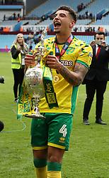Norwich City's Ben Godfrey lifts the Sky Bet Championship winners trophy as the team celebrate winning the Sky Bet Championship at Villa Park in Birmingham.
