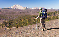 A backpacker looks at Mt. Lassen from the top of the Lassen Cinder Cone.