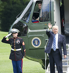 June 30, 2017 - Washington, District of Columbia, United States of America - United States President Donald J. Trump waves to guests as he and and first lady Melania Trump and son Barron depart the White House in Washington, DC for a weekend in Westminster, NJ on Friday, June 30, 2017. .Credit: Ron Sachs / CNP (Credit Image: © Ron Sachs/CNP via ZUMA Wire)