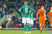 Northern Ireland midfielder Steven Davis (8) with his hands on his hips following the UEFA European 2020 Qualifier match between Northern Ireland and Netherlands at National Football Stadium, Windsor Park, Northern Ireland on 16 November 2019.