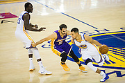 Golden State Warriors guard Stephen Curry (30) beats teh Los Angeles Lakers defense at Oracle Arena in Oakland, Calif., on November 23, 2016. (Stan Olszewski/Special to S.F. Examiner)