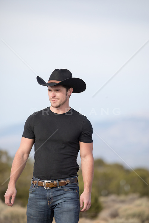 rugged cowboy outdoors on a range