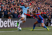 Manchester City forward Sergio Aguero (10) battles for possession with Crystal Palace midfielder Andros Townsend (10) during the Premier League match between Crystal Palace and Manchester City at Selhurst Park, London, England on 14 April 2019.