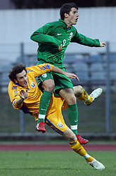 Stefan Barboianu of Romania vs Vito Plut (9)  of Slovenia during Friendly match between U-21 National teams of Slovenia and Romania, on February 11, 2009, in Nova Gorica, Slovenia. (Photo by Vid Ponikvar / Sportida)