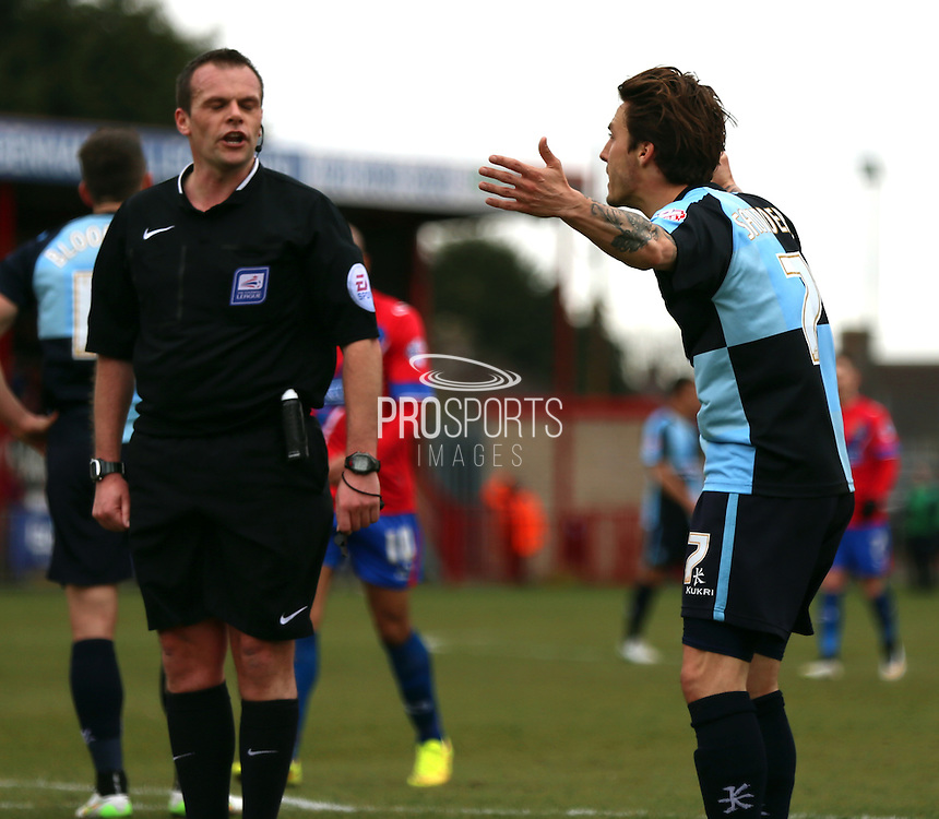 Sam Saunders arguing with ref over handball and whether it should have been a penalty during the Sky Bet League 2 match between Dagenham and Redbridge and Wycombe Wanderers at the London Borough of Barking and Dagenham Stadium, London, England on 28 March 2015. Photo by Matthew Redman.